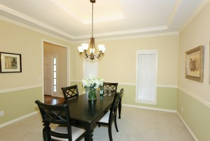 Formal dining to the left of foyer; beautiful crown molding and coffered ceiling; fresh paint, new chandelier