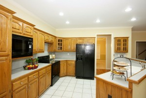 Plenty of cabinets in this kitchen, newer appliances, canned lighting, tiled floor
