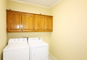 Separate inside utility with several cabinets & counter tops - washer & dryer remain