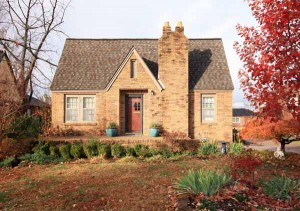 Simply picture-perfect landscaping in both front and back; nice paved walk from drive to porch