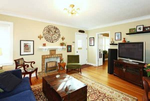 Spacious formal living with plenty of room for large furniture and television; office (or 3rd bedroom) off to side, separated by French doors