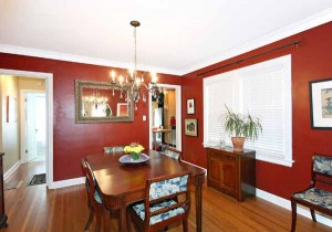Formal dining with handsome hardwood flooring; windows bringing sunlight from north