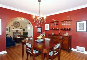 Formal dining separated from formal living by beautiful archway