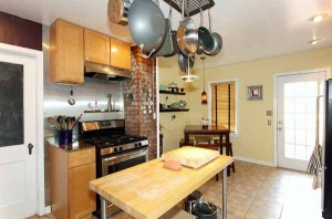 OVER-sized kitchen for area; remodeled, SS appliances, breakfast nook, doorway to deck