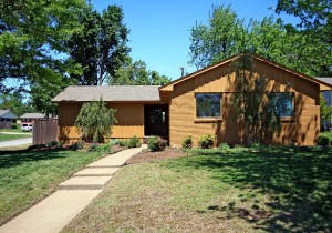 Brick exterior, walkway to covered porch, corner lot, side-entry garage