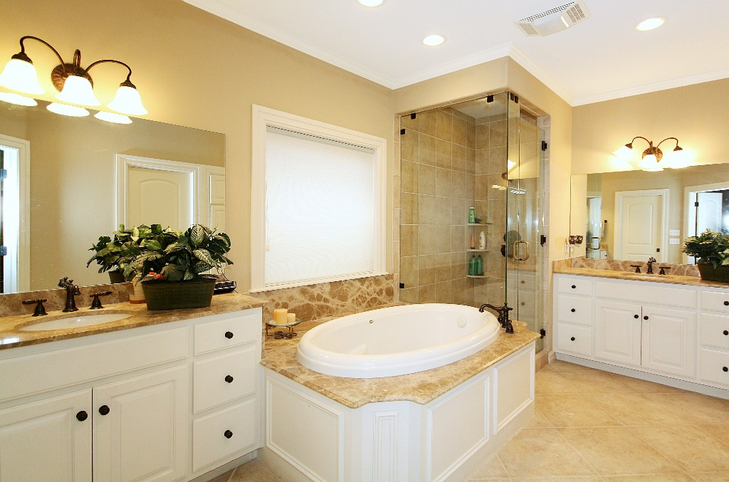 master bath includes built-in cabinetry, whirlpool bath, and separate shower.