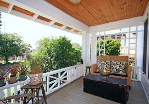 Wrap around porch with custom door from Garden Deva