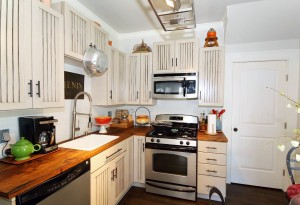 Updated kitchen with custom cabinetry in midtown Tulsa home for sale in Stonebraker Heights