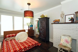 2nd bedroom with decorative fireplace in midtown Tulsa home for sale