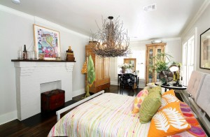 Large master bedroom with decorative fireplace in historic midtown Tulsa home for sale in Stonebraker Heights