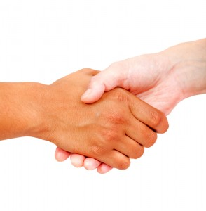 shaking hands after negotiating