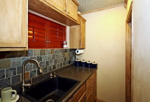 Garage apartment kitchen with stackable washer/dryer around corner