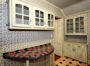 Kitchen breakfast bar, additional cabinetry, door to office