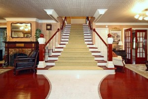 Tiled entry and grand staircase in midtown Tulsa home for sale near River Parks