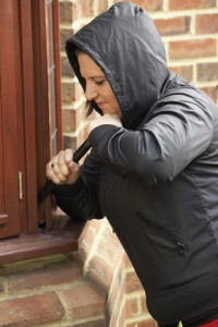 Young Woman Breaking Into House