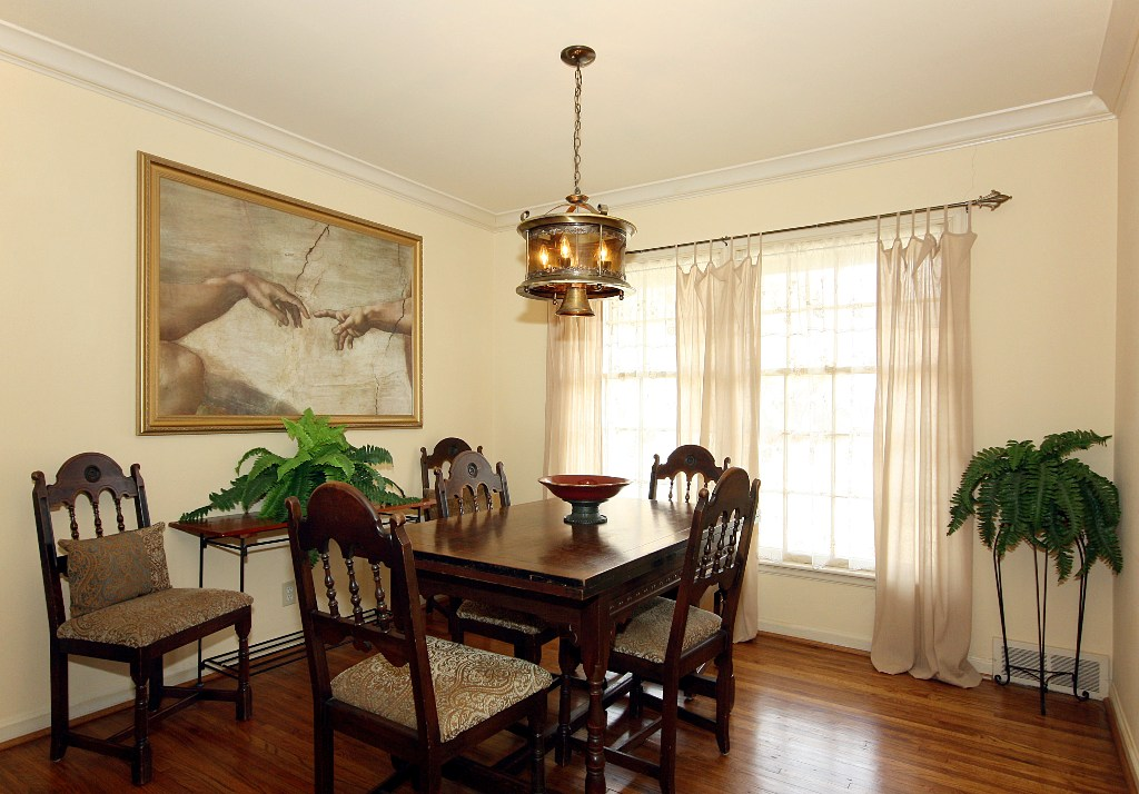 The Formal Living Room Includes A Beautiful Brick Fireplace And Windows To North South All Rooms Have Been Updated With Designer Paint