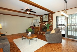 Den with beautiful parquet wood flooring, fireplace, access to sunroom