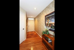 Spacious entry in midtown Tulsa condo with hall closet and guest bath