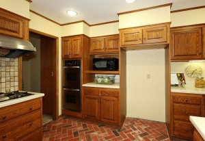 Double ovens - laundry and half-bath to the left