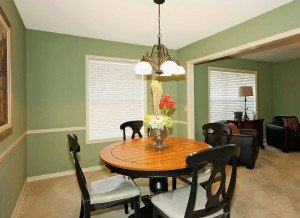 Formal dining room with chair railing, white accents, large window