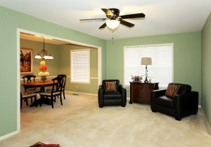 View of formal living and formal dining with new light fixtures