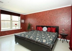 Master bedroom on painted cement floor