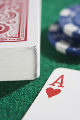 Deck of cards and chips with ace of hearts