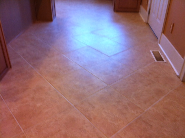 kitchen floor cleaned and stained grout
