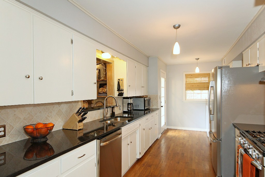 Kitchen with refinished cabinets, new granite counters, new SS appliances
