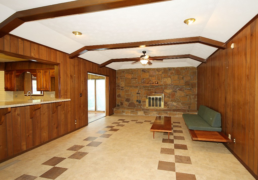 den toward fireplace wall