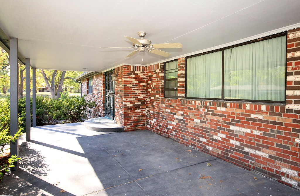 tulsa home for sale on 1+ acres with large covered porch