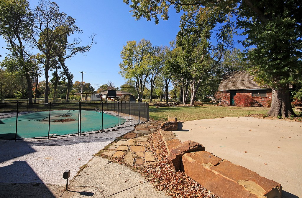 two patio areas in tulsa home for sale with 1+ acre and pool