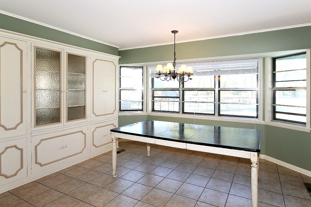 tulsa home for sale on acreage with dining area and window overlooking swimming pool