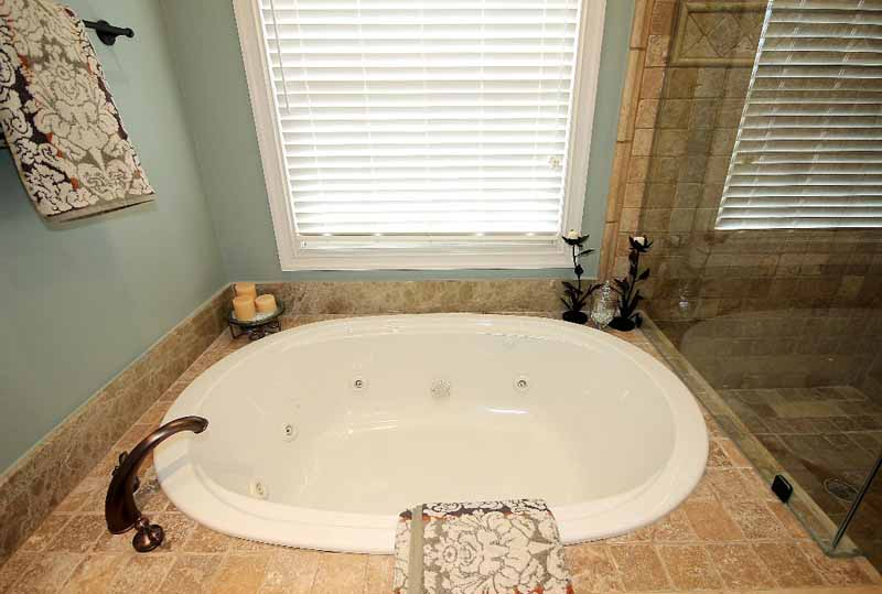 master bath with whirlpool and shower