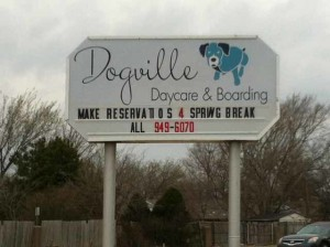 sign for Dogville Daycare and Boarding