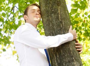 image of man hugging tree