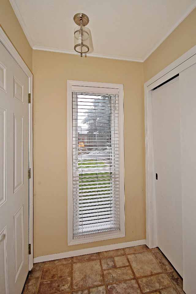 tled entry with window and coat closet