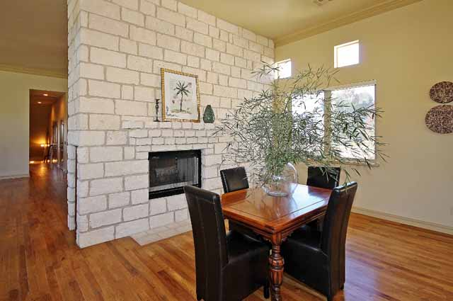 formal dining by fireplace