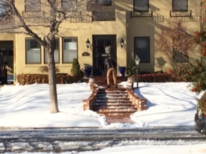 shoveling snow on steps for safe entry
