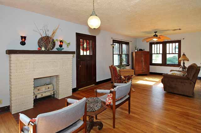 formal living with fireplace in bungalow for sale in midtown Tulsa