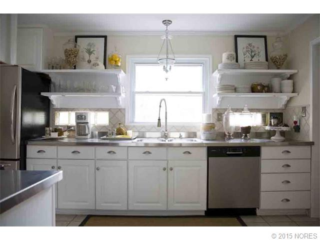 Who doesn't like a light, bright and open kitchen.  Updated with