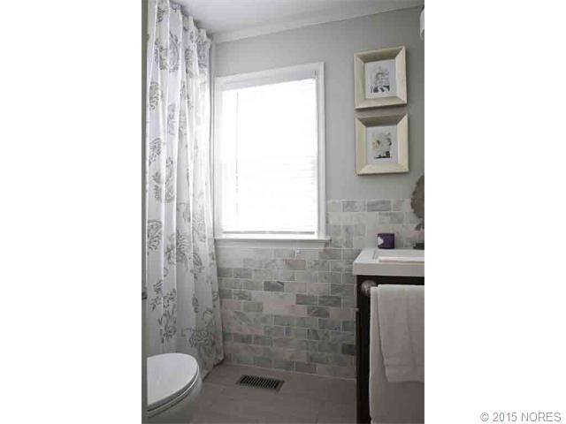 Updated master bath with Carrera Marble subway wall tiles and la