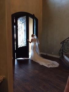 bride looking out doors